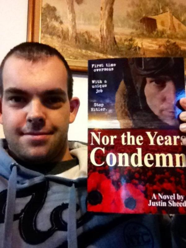 Nathan Hunt with his copy of Nor the Years Condemn, purchased at Dymocks Bookstore, George St, Sydney