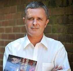"Justin Sheedy, author of ""Nor the Years Condemn'"