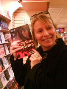 "Dymocks Bookstore Customer Nick with her copy of ""Nor the Years Condemn"""
