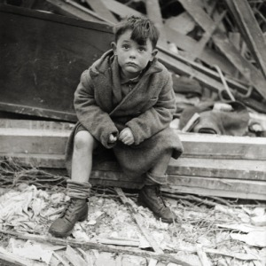 A famous image, boy next to bombed-out home, WWII London