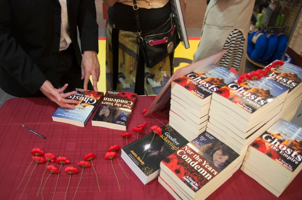 "Signing table with all 3 of Sheedy's books - ""Ghosts of the Empire"", ""Nor the Years Condemn"" & his childhood story ""Goodbye Crackernight"""