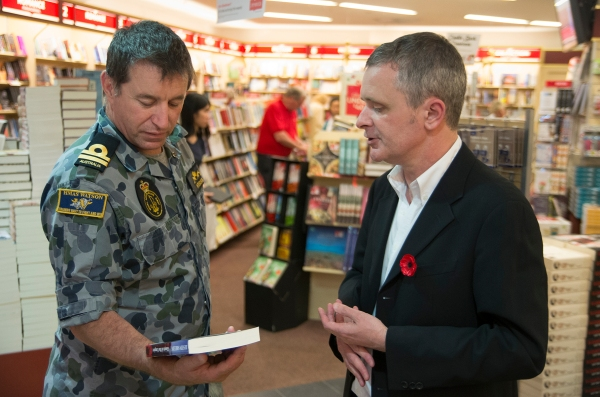"About to sign a copy of ""Ghosts of the Empire"" for a serving Submarine Lieutenant of the Royal Australian Navy"
